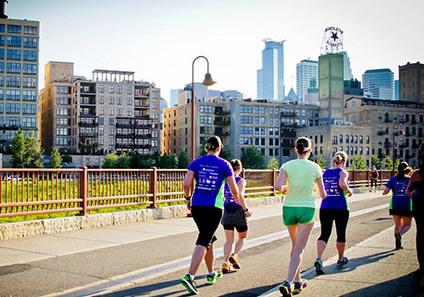 Runners with skyline in background