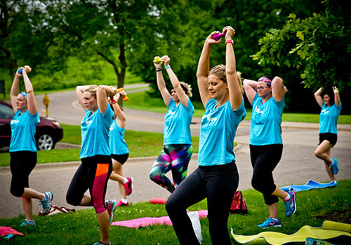 Women with dumbells during Strength and Cardio Boot Camp
